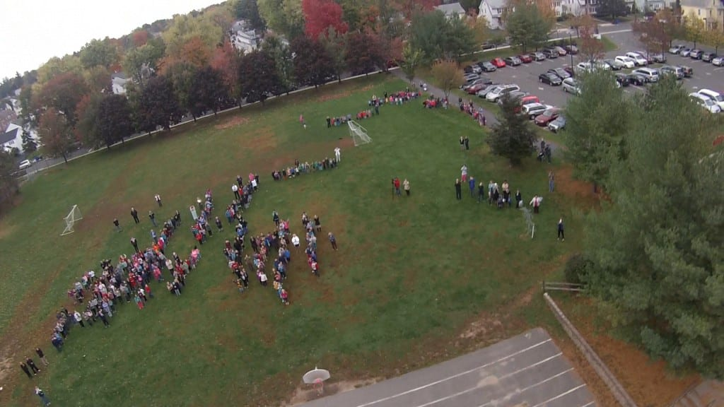 A goPro camera aboard the weather balloon photographs the Smith STEM school community watching from below. Submitted photo.