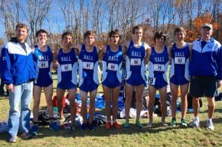 Hall XC team and coaches (l-r): Asst. Coach Jeff Billing, Ari Klau, Ben Gross, John Cassidy, Max Aronow, Grant O'Connor, Devon Aldave, Jonathan Kaback, and Coach Tom Butterfield. Photo credit: Ronni Newton