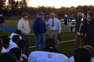 Past and present coaches at the Nov. 20, 2010 Mayor's Cup Conard vs. Hall football game. From left: Robert McKee, Frank Robinson, Rob Cersosimo, Frank Robinson III (in background). Conard file photo