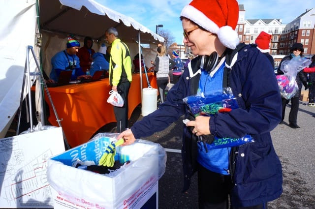 Participants donated mittens, gloves, hats, and scarves to The Town That Cares Fund. Annual Blue Back Mitten Run, West Hartford, Dec. 7, 2014. Photo credit: Ronni Newton