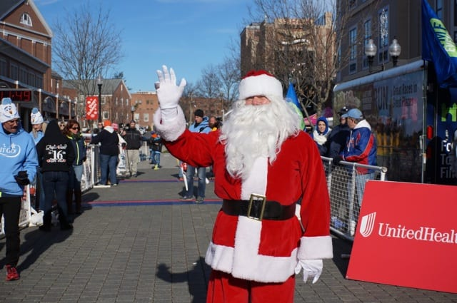 Santa waits to high-five finishers. Annual Blue Back Mitten Run, West Hartford, Dec. 7, 2014. Photo credit: Ronni Newton