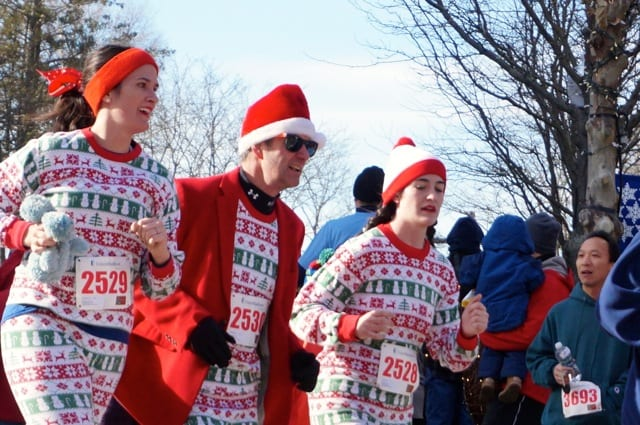 Paul Connery (center) ran with his daughters Micaela (left, the founder and former executive director of Unified Theater) and Keenan (right), decked out in Christmas pjs. Annual Blue Back Mitten Run, West Hartford, Dec. 7, 2014. Photo credit: Ronni Newton