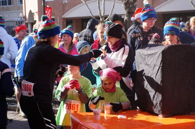 Runners enjoyed hot chocolate at the finish line. Annual Blue Back Mitten Run, West Hartford, Dec. 7, 2014. Photo credit: Ronni Newton