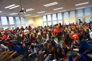 An overflowing room full of students attended the discussion about changing the school's mascot and logo at Conard's Human Rights Day. Photo credit: Ronni Newton