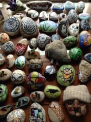 Rocks painted by Julie Phillips include one with a knit cap. Courtesy of Julie Phillips