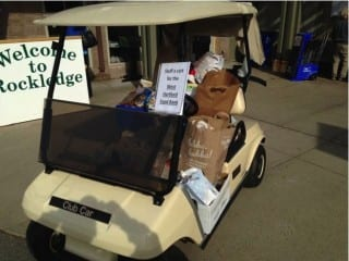 Participants in the Rockledge Men's Club Tournament also stuffed a golf cart full of non-perishables for the West Hartford Food Pantry. Submitted photo