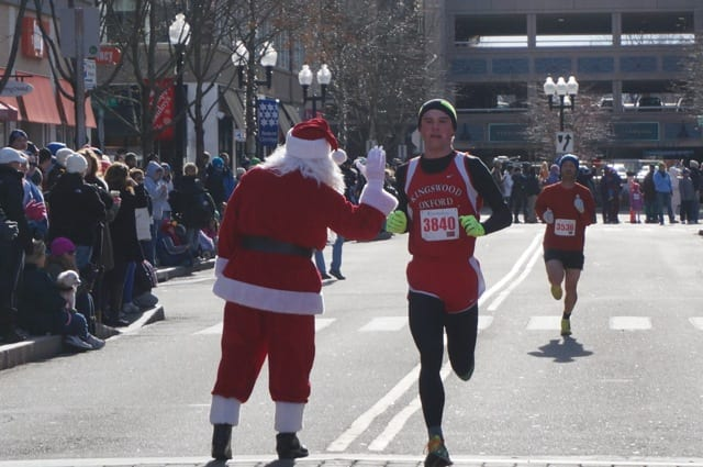 Mick Hains, 16, of West Hartford, is a junior at Kingswood Oxford. He finished 17th overall and third in the 15-19 age group. Annual Blue Back Mitten Run, West Hartford, Dec. 7, 2014. Photo credit: Ronni Newton