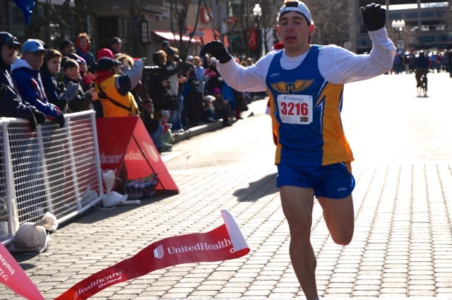 Bobby Giuliani of West Hartford was the first-place finisher in a time of 16:07. Annual Blue Back Mitten Run, West Hartford, Dec. 7, 2014. Photo credit: Ronni Newton