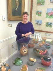 Artist Marilyn Holt with her display of gourd art at the Noah Webster Library (on display for the month of February). Photo by Paulette Mertes
