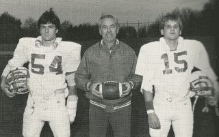 Coach Frank Robinson flanked by 1984 Hall High School football team co-captains Jamie Martin and Rick Raterman. Photo courtesy of 1984 Hall High yearbook