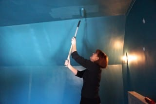 Laurie Nilsen, of Nilsen Design, paints her space 'North Sea Green.' Photo credit: Ronni Newton
