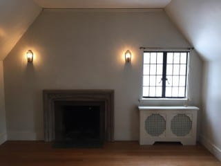 'Before' view of the fireplace and white walls in Nilsen's Design's future 'Dream Office.' Courtesy photo