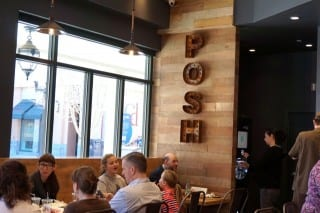 Posh Tomato's interior has a distinctive appearance, with natural wood, white subway tile and other raw materials that modernize the traditional, vintage pizzeria. Photo credit: Ronni Newton
