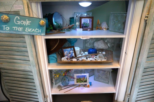 Artist Tina McDowell's beach-themed linen closet. 2015 Junior League Decorator Show House. Photo credit: Ronni Newton