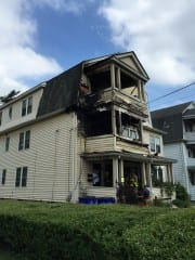 A fire at a multi-family residence at 198-200 did extensive damage to the second and third floor porches. Photo credit: John Lyons