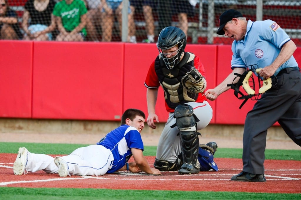 Hall's Neil Kelley attempts to steal home and is tagged out at the plate by Conard catcher Henry Fracasso. Photo courtesy of Andrew Stabnick, LowTide Photography