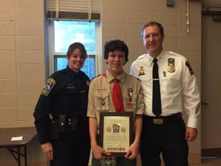 Hall High School junior Gregory Donovan (center) was received a Citizen Award from West Hartford Animal Control Supervisor Karen Jones (left) and Assistant Police Chief Daniel Coppinger on June 10. Photo courtesy of Anne Donovan