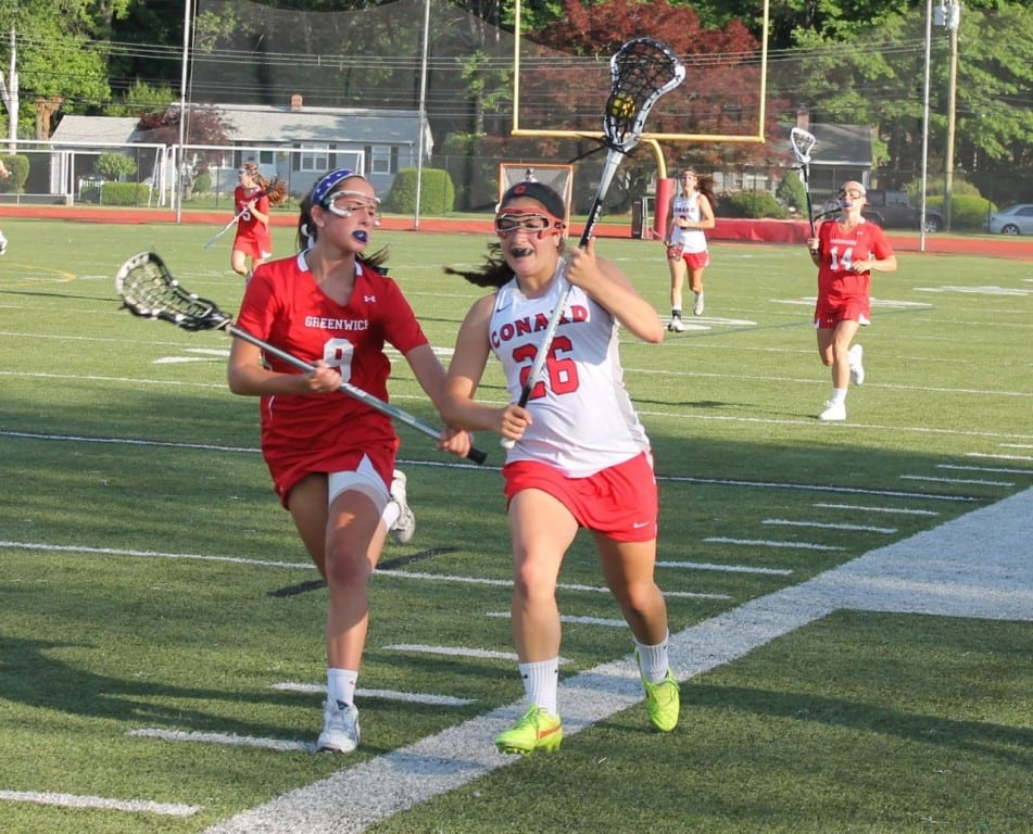 Conard sophomore Maya Feigenbaum (#26) sprints down the field trailed by Greenwich's Lilly Pochintesta. Submitted photo