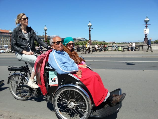 An elderly couple in Denmark enjoys a ride in a specialized rickshaw. Courtesy photo