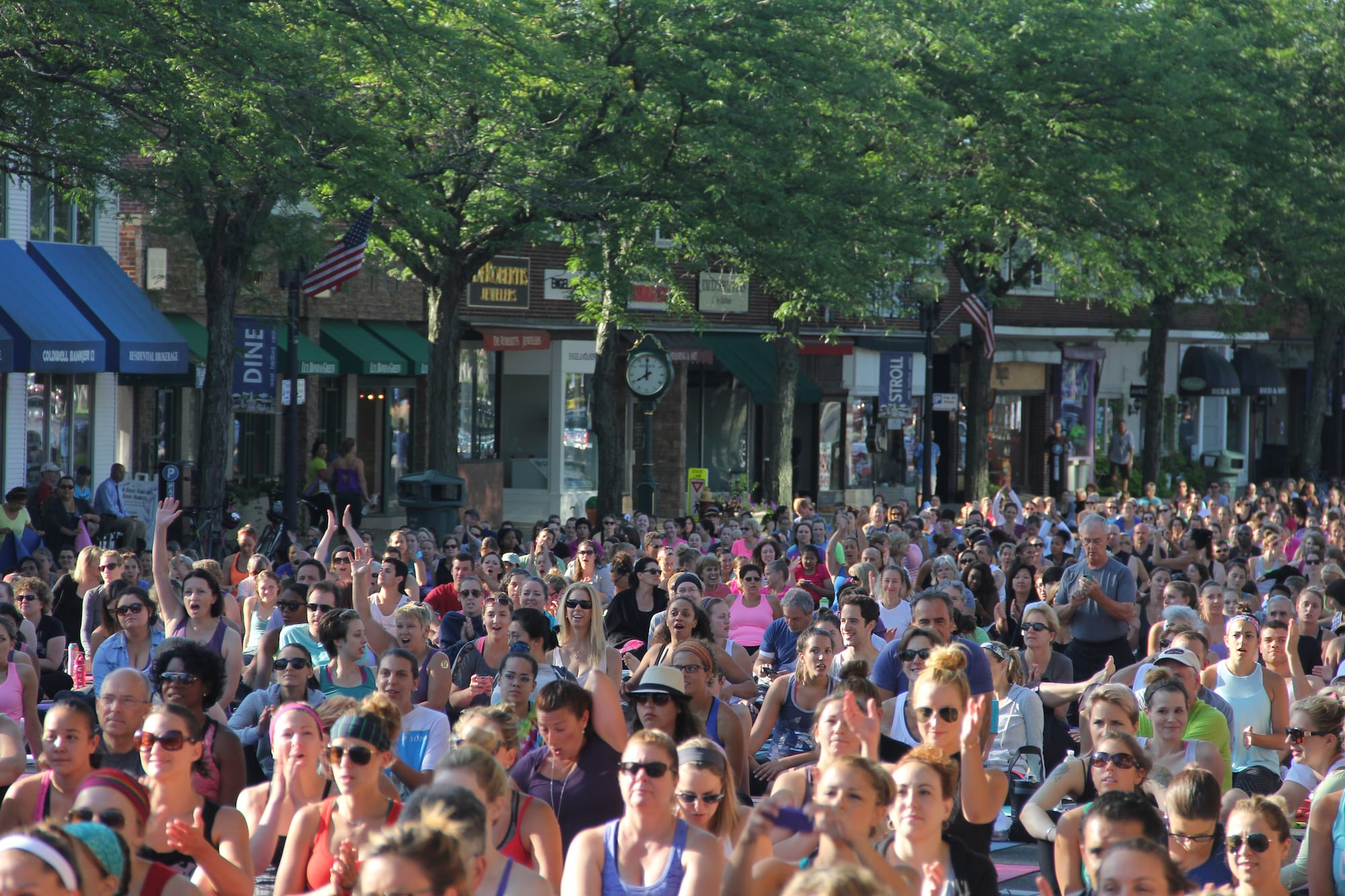 Om Street 2015, presented by West Hartford Yoga on LaSalle Road, July 25, 2015. Class is just about to begin, (notice the time on the Rolex clock). Photo by Amy Melvin