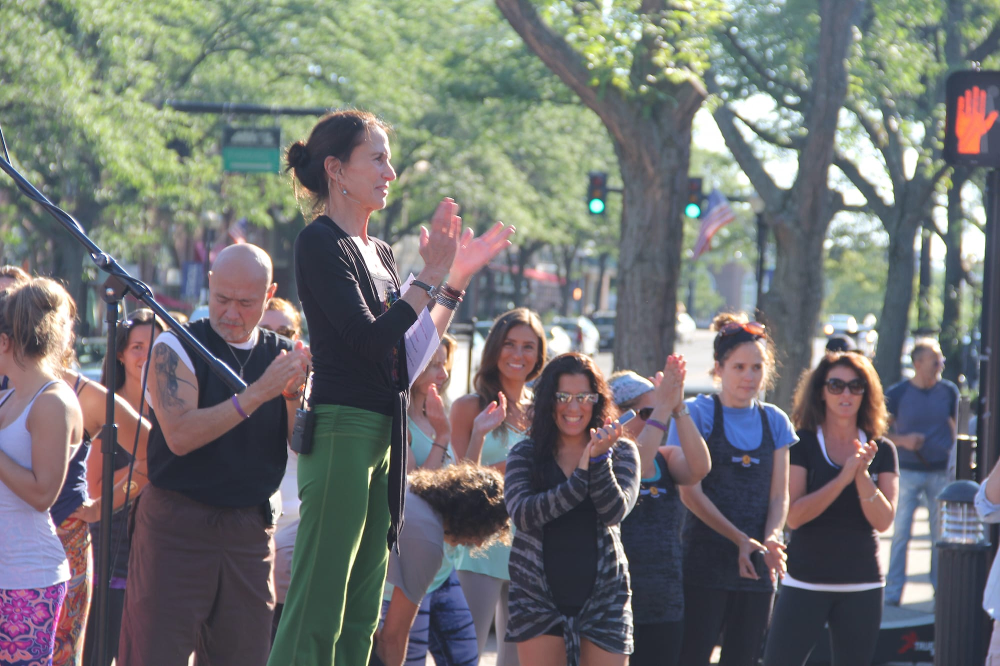 Om Street 2015, presented by West Hartford Yoga on LaSalle Road, July 25, 2015. Barbara Ruzansky surrounded by fellow instructors and participants. Photo by Amy Melvin
