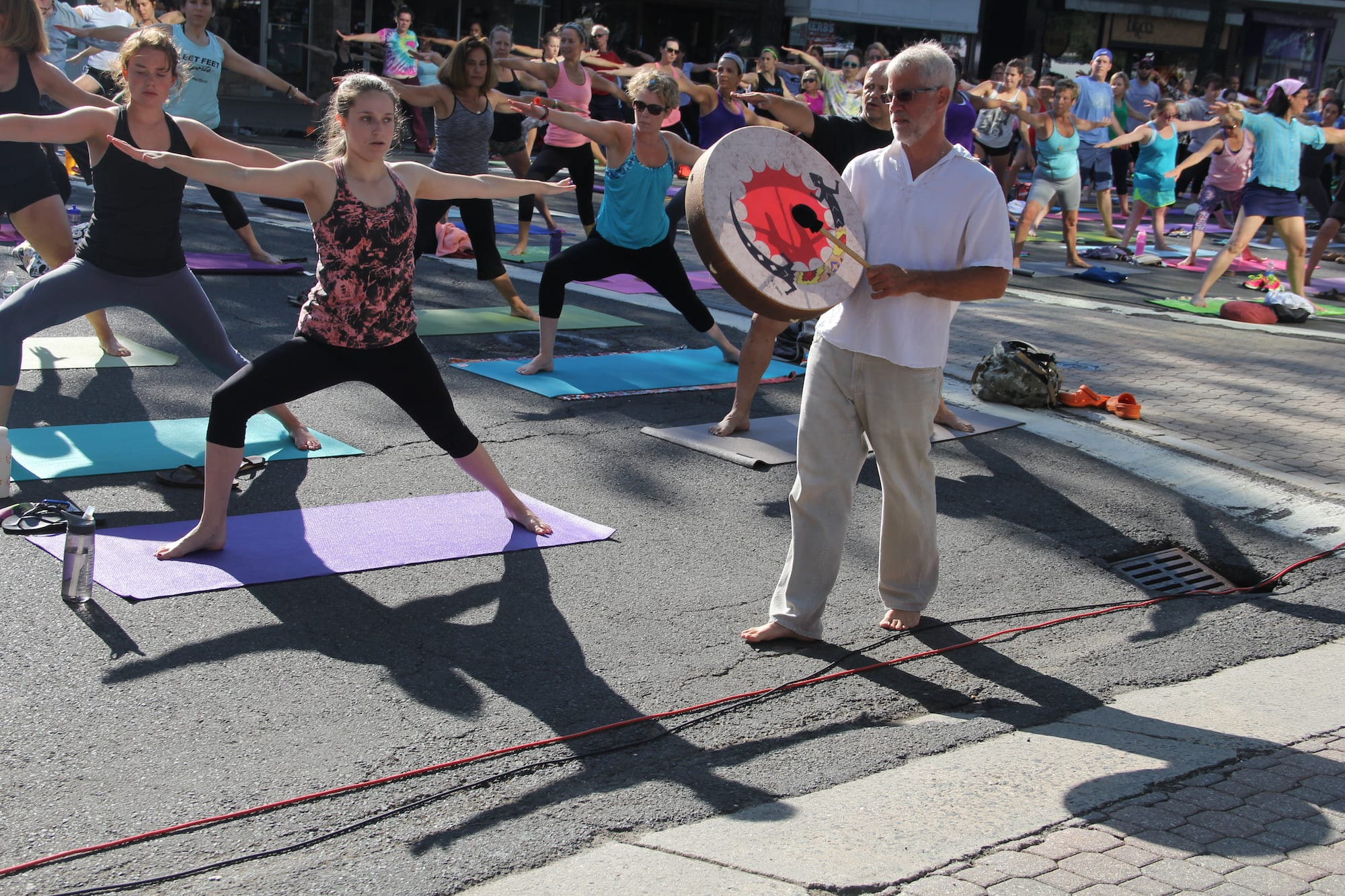 Om Street 2015, presented by West Hartford Yoga on LaSalle Road, July 25, 2015. Craig Norton, with Hands on Drumming, strolled and drummed. Photo by Amy Melvin