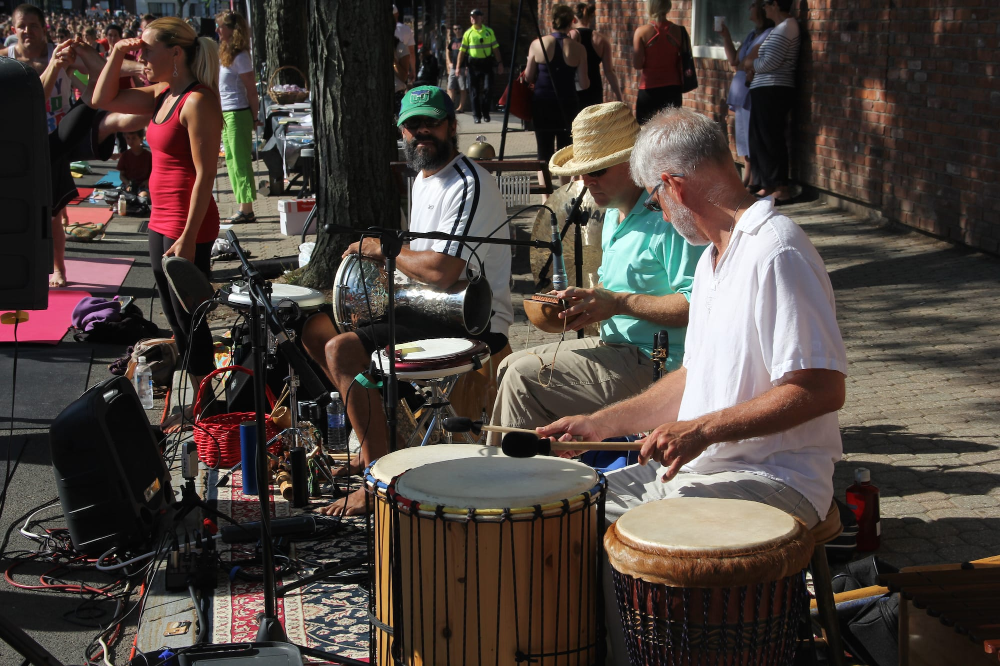 Om Street 2015, presented by West Hartford Yoga on LaSalle Road, July 25, 2015, with musical accompaniment by Hands on Drumming with Craig Norton. Photo by Amy Melvin