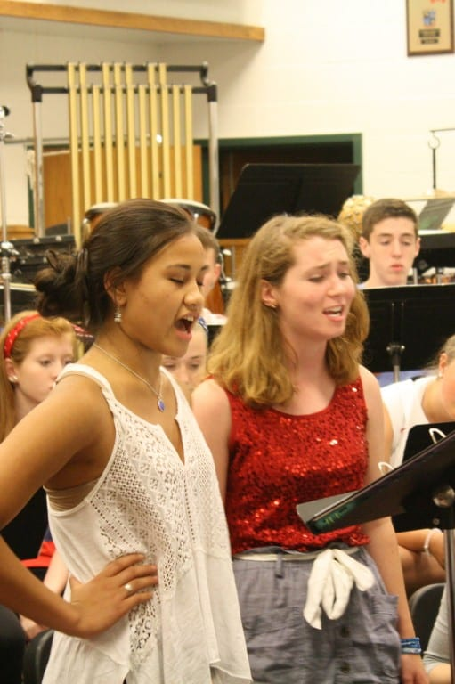 "Emily Bautista (left) and Brigid Lucey (right) sing Anita and Maria's duet, ""A Boy Like That/I Have a Love"", in rehearsal. Submitted photo."