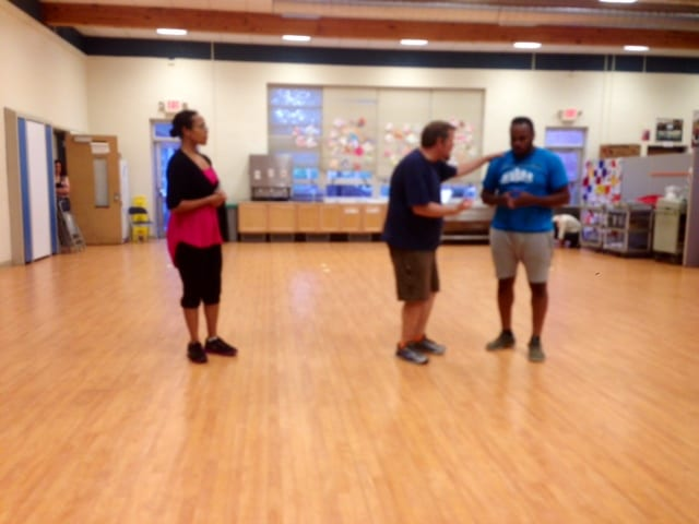 Actors rehearsing a scene. Photo by Katie Cavanaugh.