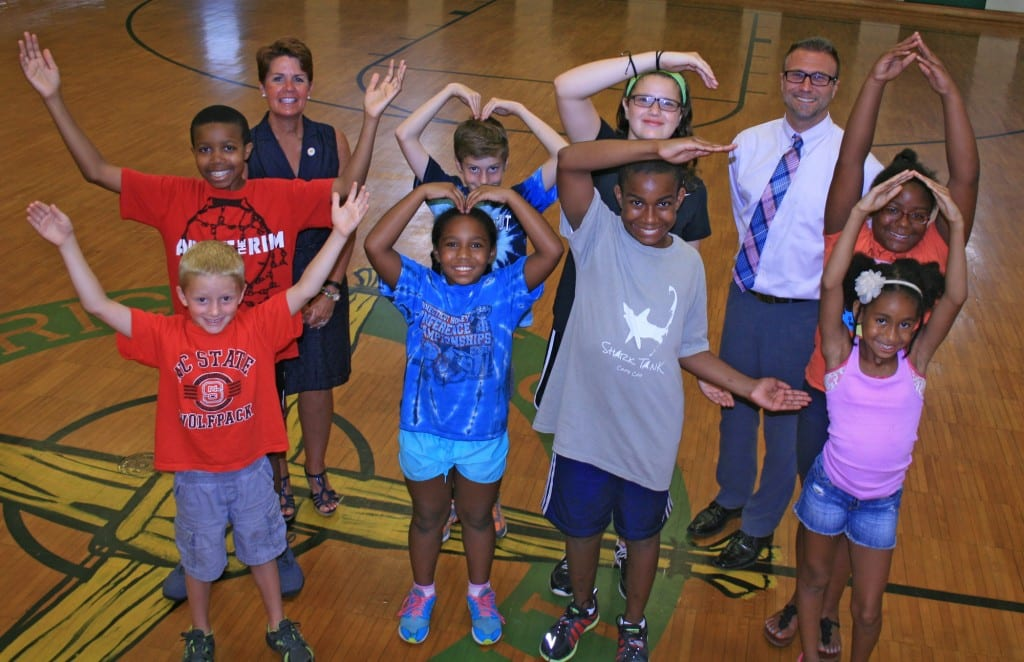 Saint Brigid School Principal Shevon Hickey with Shawn Fongemie, Executive Director of the West Hartford YMCA, and some happy YMCA campers (spelling YMCA), at the school campus in West Hartford. Photo by Joy Taylor