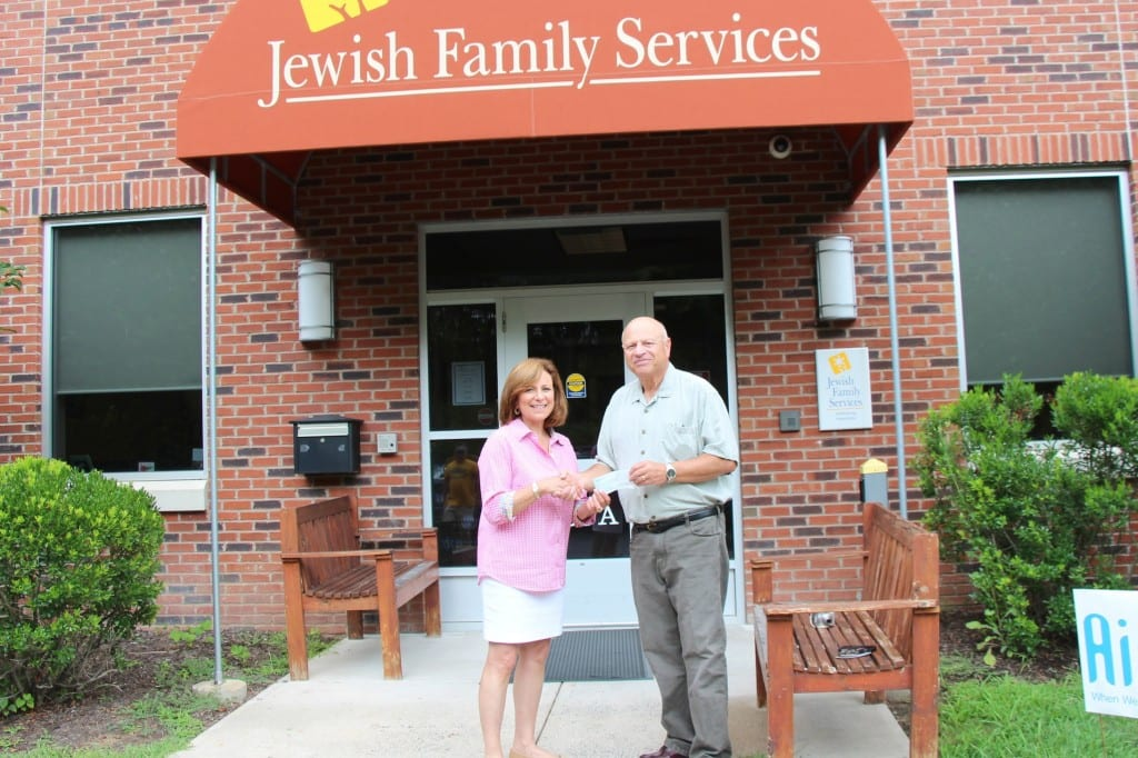Bob Tellar of Emanuel Synagogue Brotherhood presents the donation check to Patti Weiner of JFS for the JFS Anja Rosenberg Kosher Food Pantry. Submitted photo