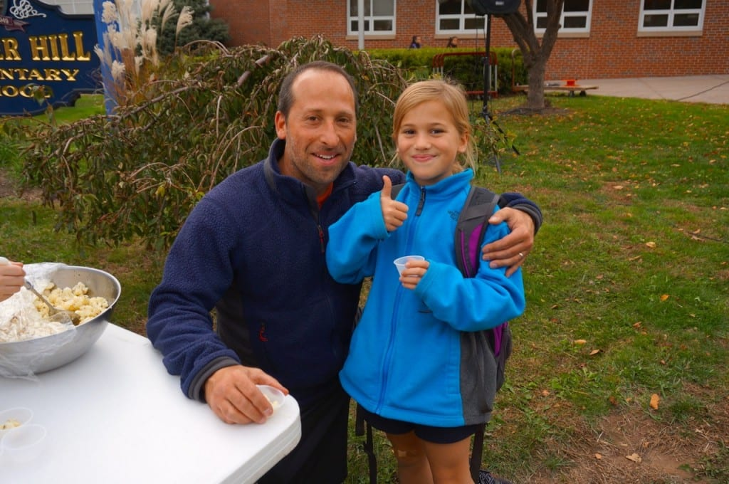 Emma Marcella (with her dad, Glenn Marcella) gives the cauliflower a thumbs up. Photo credit: Ronni Newton