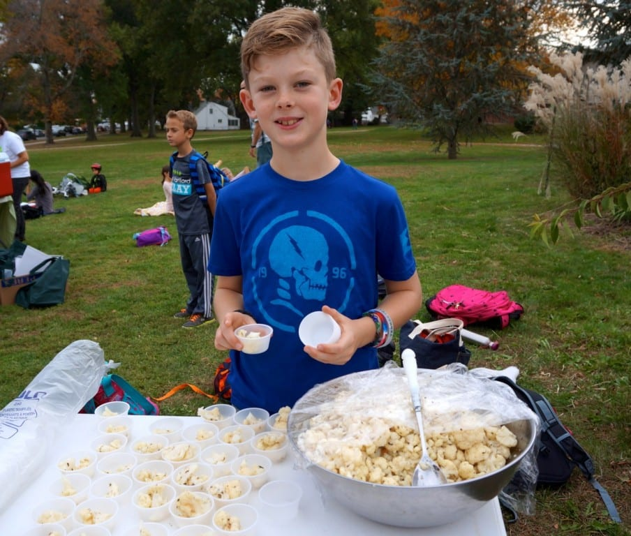 Webster Hill fourth-grader Will Keever hands out samples of herbed and marinated cauliflower at the farmers' market. Photo credit: Ronni Newton