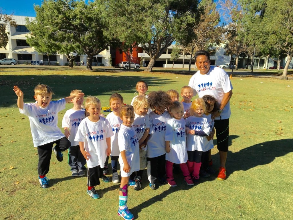 Coach Milton and participants in a Socceropolis program. Submitted photo