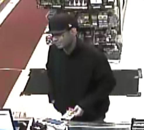 West Hartford Police are asking for the public's help in identifying this suspect in the robbery of House of Tobacco. Note distinctive tattoo under his left eye. Photo courtesy of West Hartford Police