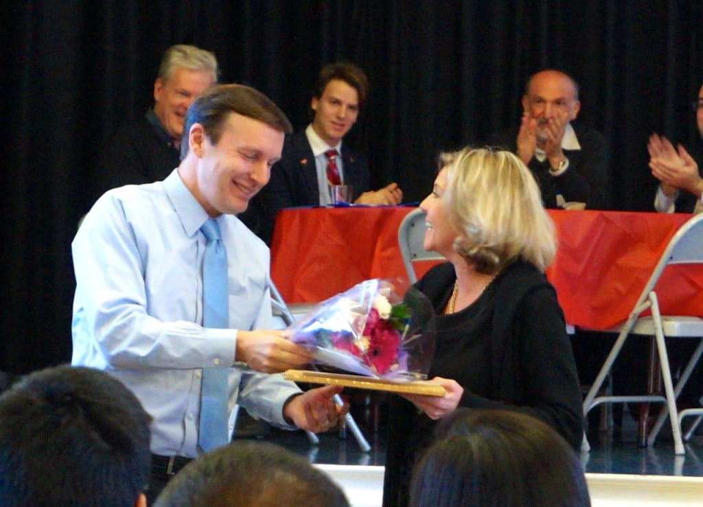 U.S. Sen. Chris Murphy recognizes staffer and Director of Special Projects Lee Murphy for her 20 years of service at 'Pancakes and Politics' breakfast at the Elmwood Community Center, Nov. 23, 2015. Photo credit: Ronni Newton