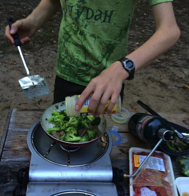 A member of Troop 146 cooks up a great camp dinner. Submitted photo