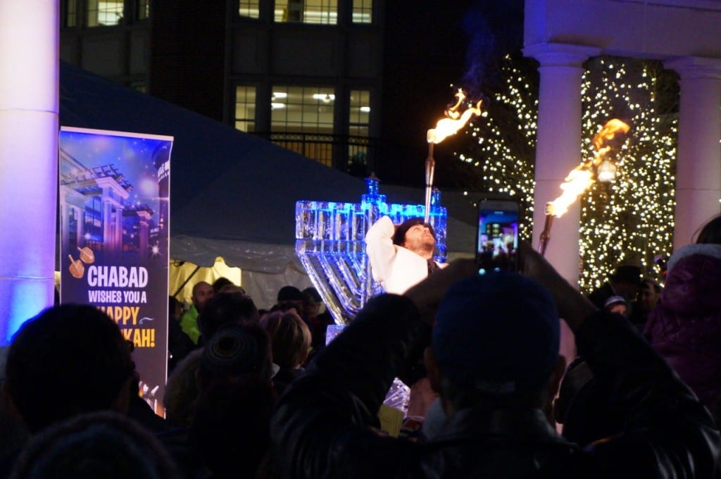 Jason Pipitone juggles fire. Chabad of Greater Hartford's 'Fire on Ice,' Dec. 6, 2015. Photo credit: Ronni Newton