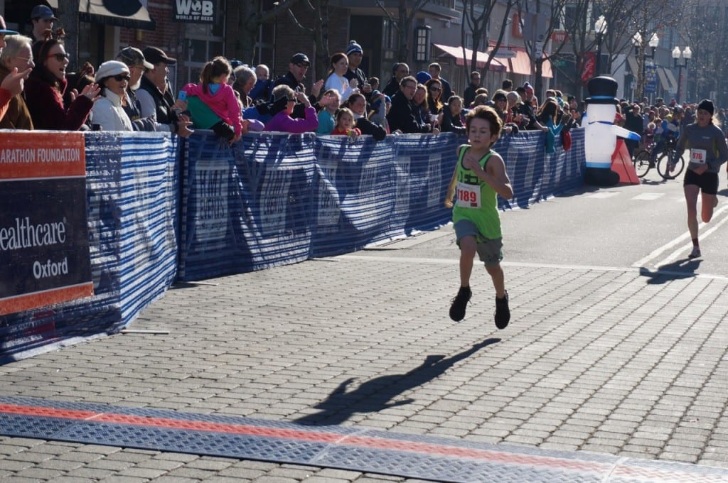 Aiden Puffer, 11, of Manchester won the 10-14 age group in an amazing time of 18:31.51. HMF Blue Back Mitten Run, West Hartford, Dec. 6, 2015. Photo credit: Ronni Newton