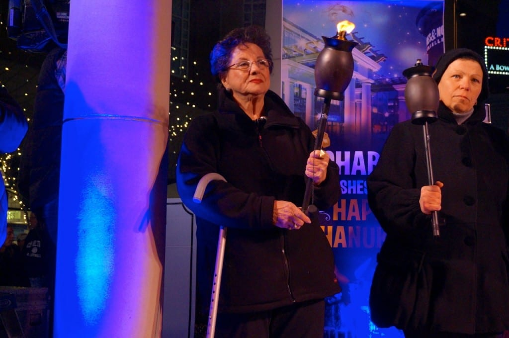Holocaust survivor Nina Jacobs starts off the Torch of Jewish Continuity. Chabad of Greater Hartford's 'Fire on Ice,' Dec. 6, 2015. Photo credit: Ronni Newton