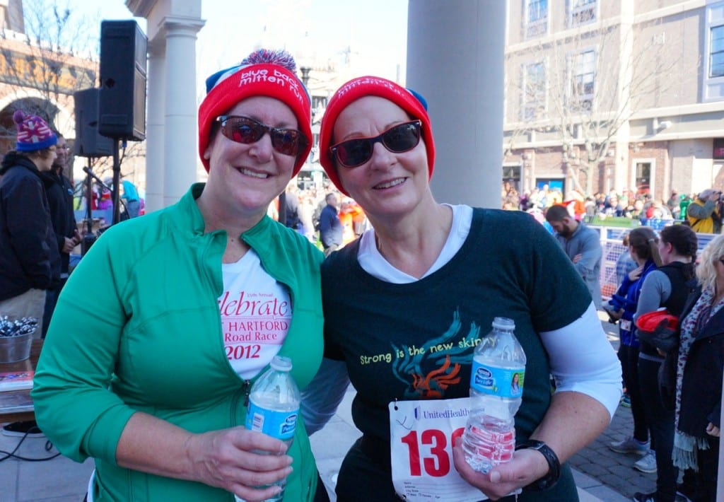 West Hartford resident Debbi Zimbler (left) and New Britain resident Andrea Bucior-Kulak sid they loved the knit hats, but really didn't need to wear them for the race. HMF Blue Back Mitten Run, West Hartford, Dec. 6, 2015. Photo credit: Ronni Newton