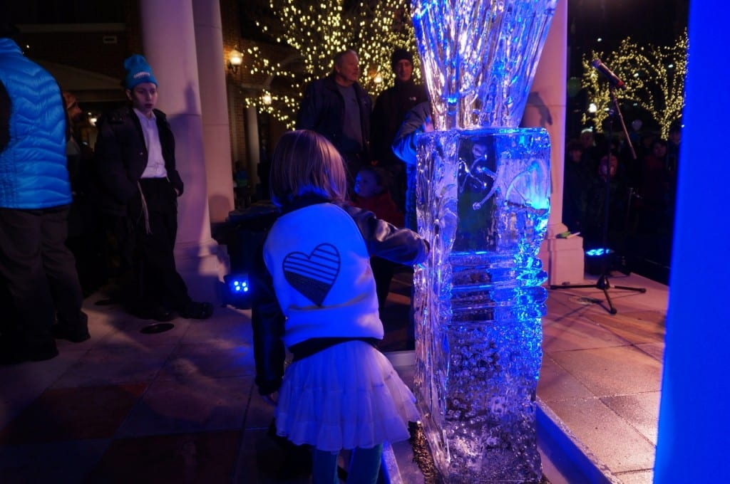 A young girl touches the menorah to discover that it really is made of ice. Chabad of Greater Hartford's 'Fire on Ice,' Dec. 6, 2015. Photo credit: Ronni Newton