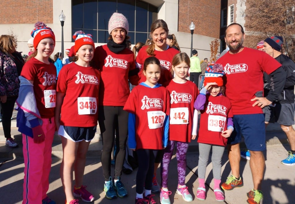 Several Girls in Stride runners pose with their coaches (from left) Janet Tarasuk, Lisa Pillow, and Glenn Marcella. HMF Blue Back Mitten Run, West Hartford, Dec. 6, 2015. Photo credit: Ronni Newton
