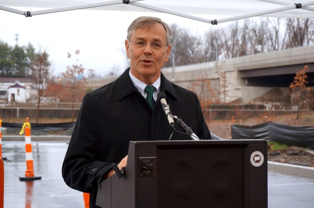 Connecticut DOT Commissioner James Redeker presides over the ribbon-cutting of new spaces at the Elmwood CTfastrak station. Photo credit: Ronni Newton