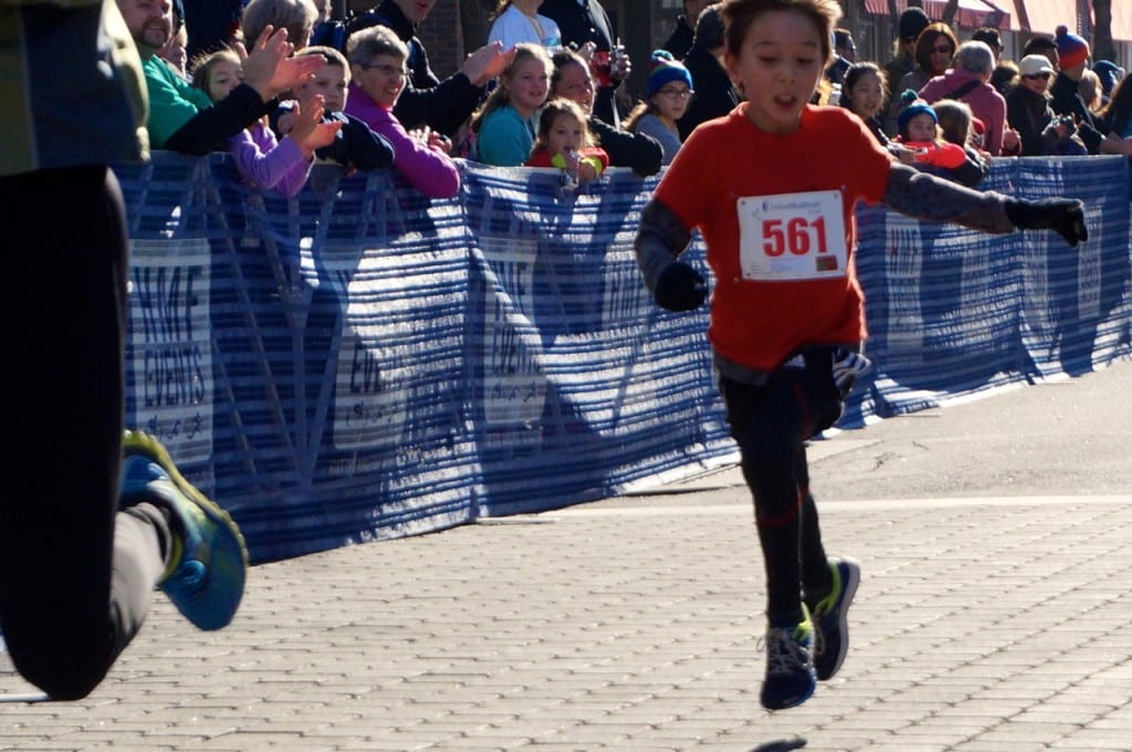 Max Huang of West Hartford, age 9, finished first in the 9 and under age group in 20:01.96. HMF Blue Back Mitten Run, West Hartford, Dec. 6, 2015. Photo credit: Ronni Newton