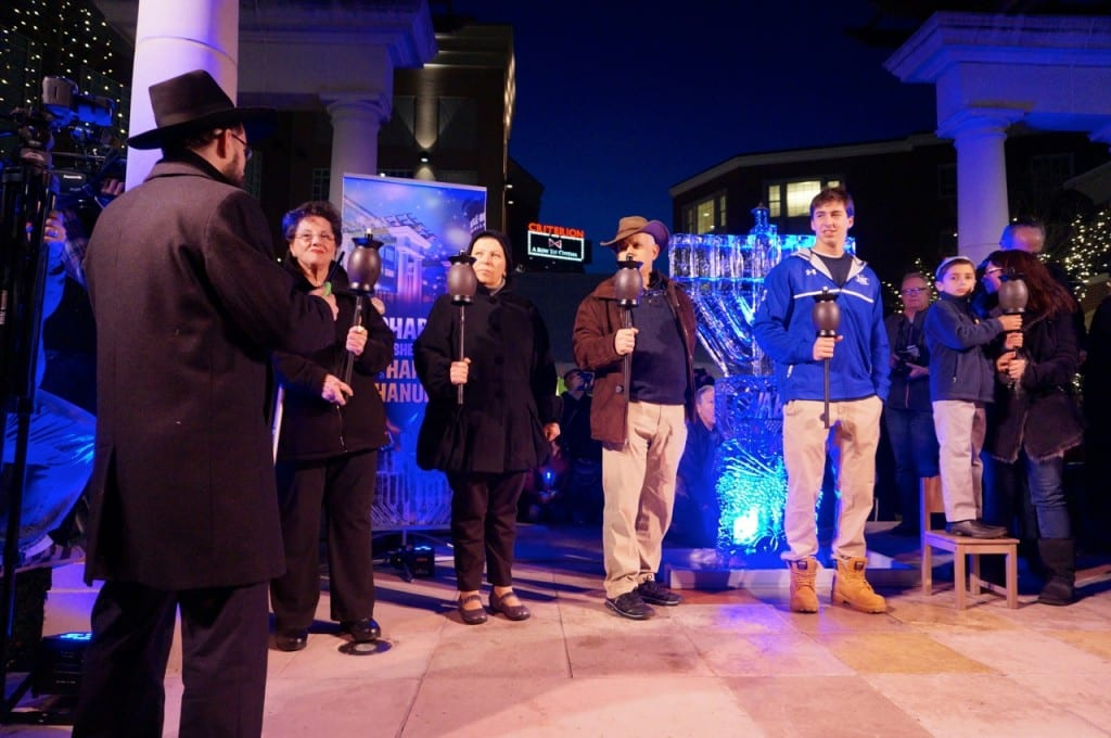 Rabbi Shaya Gopin (left) with members of the chain of continuity. Chabad of Greater Hartford's 'Fire on Ice,' Dec. 6, 2015. Photo credit: Ronni Newton