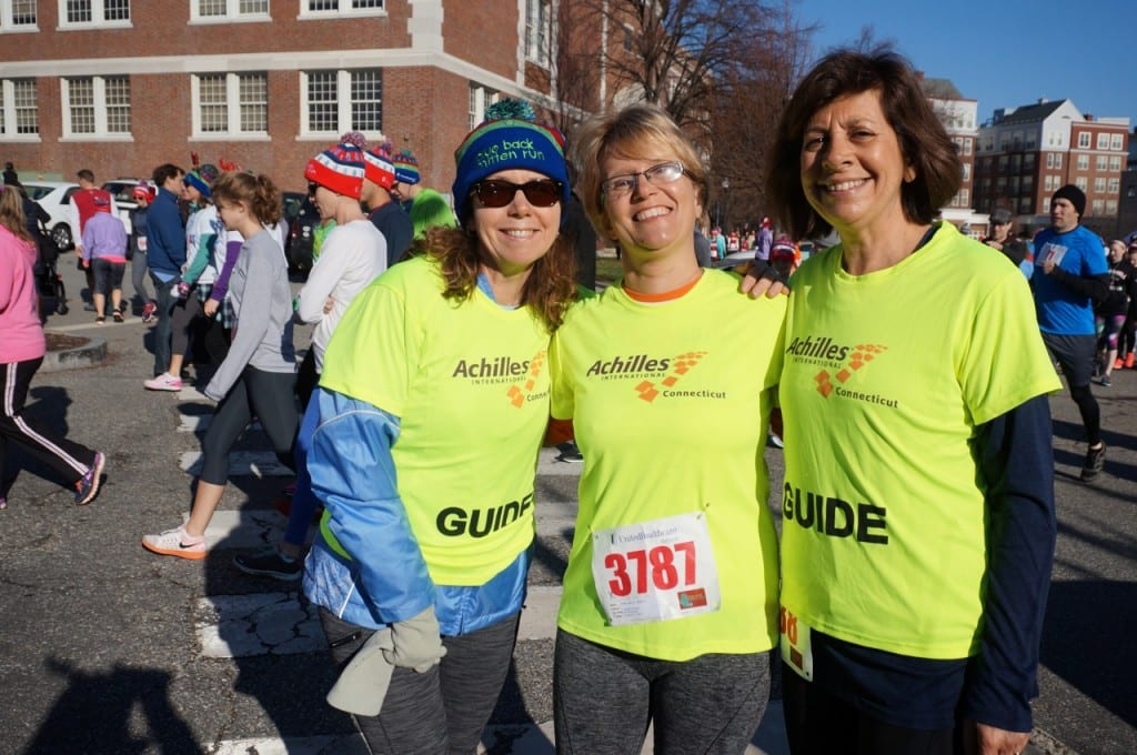 Roberta Brown of West Hartford (right) was running as an Achilles Guide. HMF Blue Back Mitten Run, West Hartford, Dec. 6, 2015. Photo credit: Ronni Newton