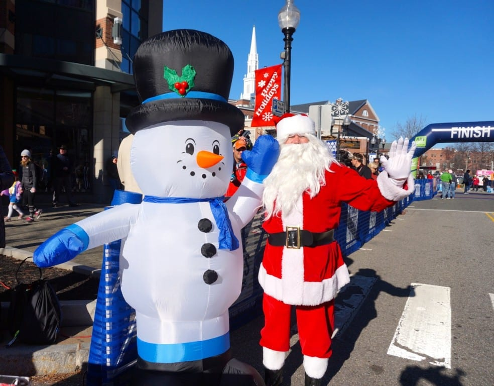 Santa and an inflatable snowman await finishers. HMF Blue Back Mitten Run, West Hartford, Dec. 6, 2015. Photo credit: Ronni Newton