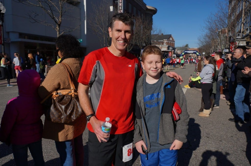 Tim Schulken of West Hartford with his son, Connor. Tim finished third in his age group. HMF Blue Back Mitten Run, West Hartford, Dec. 6, 2015. Photo credit: Ronni Newton