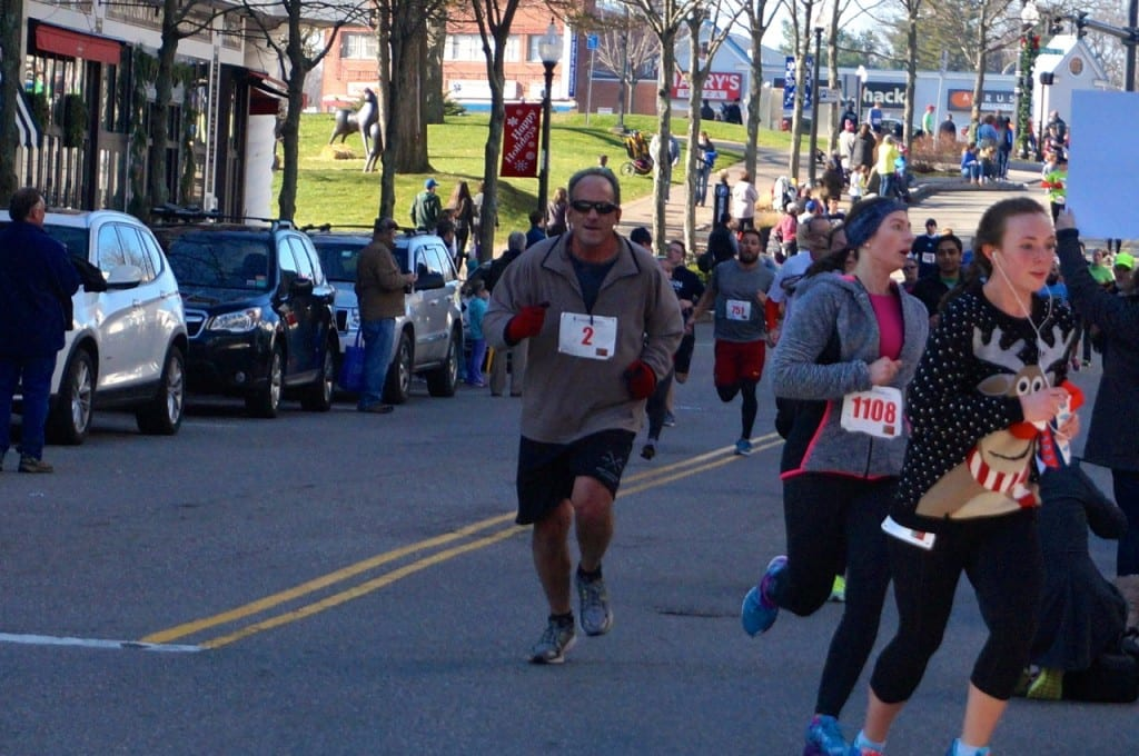 Zach Karas of West Hartford was wearing bib no. 2, which he said he was given at random when he registered Sunday morning. HMF Blue Back Mitten Run, West Hartford, Dec. 6, 2015. Photo credit: Ronni Newton